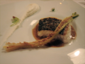 hake fillet with baby garlic, hazelnut praline, soured cream and bitter flowers