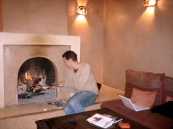 Jon and the fireplace at Riad l'Orangeraie