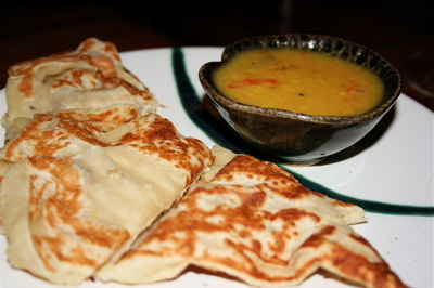 Roti canai with yellow dal