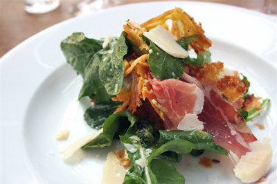 Farinata, speck and pecorino salad