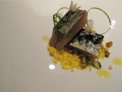 salted mackerel on a bed of egg yolk crumbles
