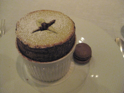 pistachio souffle served with warm chocolate sauce and macaron