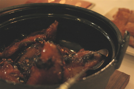 prawn-stuffed aubergine in a clay pot