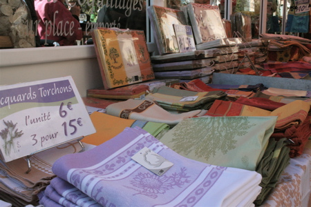 "overpriced tea towels for sale at the ""country market"" - it can only be Provence"