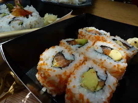 salmon-avocado rolls and prawn tempura rolls (background)